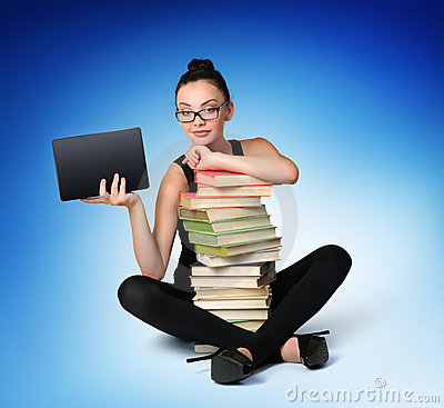 Young girl student with books and electronic table