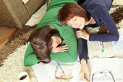 Young girl students are tired to study and sleep