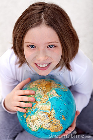 Young girl studying geography