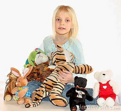 Young girl and stuffed animals