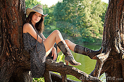 A young girl in the style of the country.