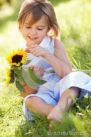 Young Girl In Summer Field Holding Sunflower