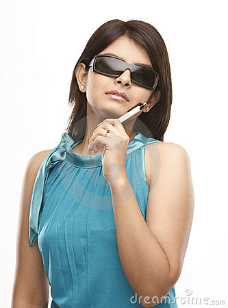 Young girl with sun-glasses holding pen