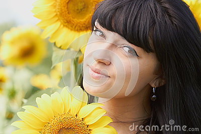 Young girl with sunflower outdoors