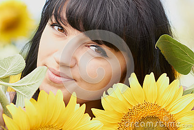 Young girl with sunflowers outdoors