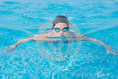 Young girl swimming butterfly stroke style