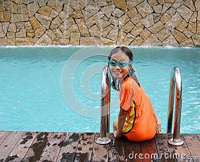 Young girl at swimming pool