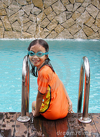 Young girl at swimming pool
