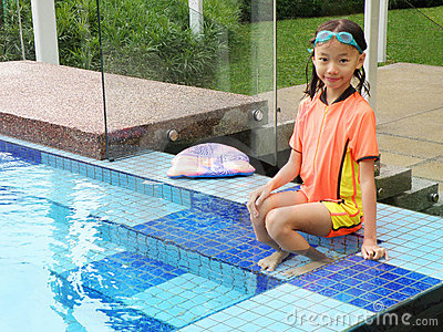 Young girl by swimming pool