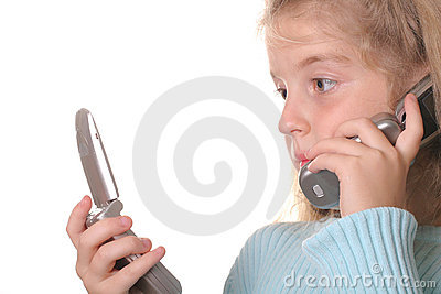 Young girl talking on a cell phone looking at anot