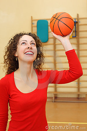 Young girl throws basketball ball