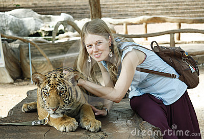 Young girl with a tiger