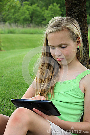 Young girl with touch tablet