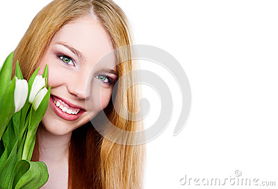 Young girl with tulips bouquet on white background