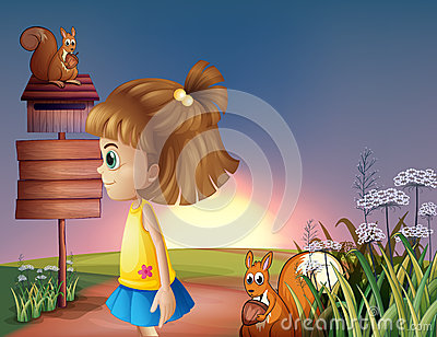 A young girl and the two squirrels near the empty signage and th