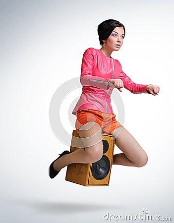 Young girl unreal flies on speaker