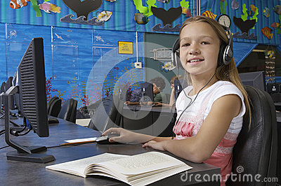 Young Girl Using Computer In Lab