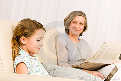 Young girl using laptop grandmother relax