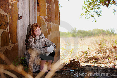 Young girl waiting at doorstep