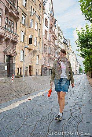 Girl walking down the street young girl walking down street 17754043