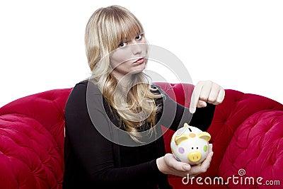 Young girl want money in her piggybank