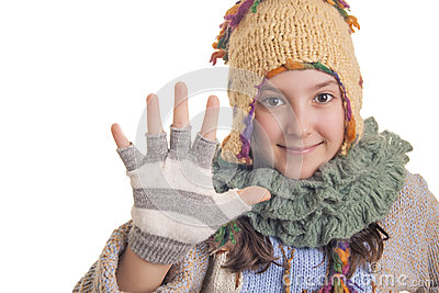 Young girl in warm winter clothes showing five