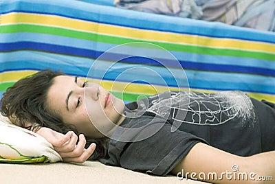Young Girl Watching TV On Floor