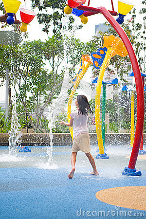 Royalty Free Stock Image: Young girl at water park