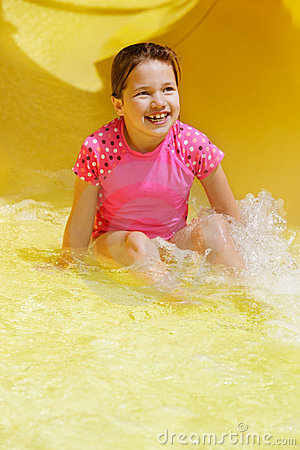 Young girl in water slide