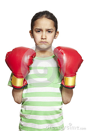 Young girl wearing boxing gloves sad and upset