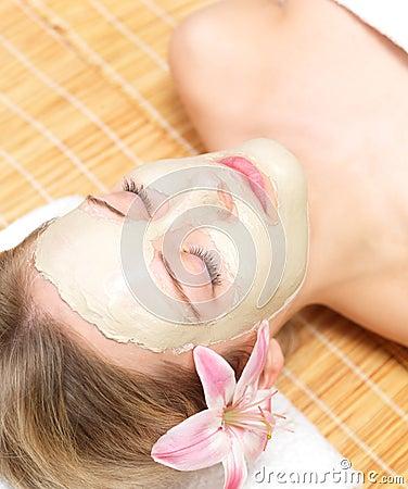 Young girl wearing facial mask