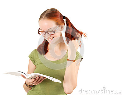 Young girl wearing glasses holding textbook.