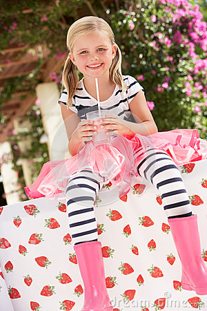 Young Girl Wearing Pink Wellington Boots