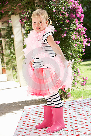 Young Girl Wearing Pink Wellington And Feather Boa