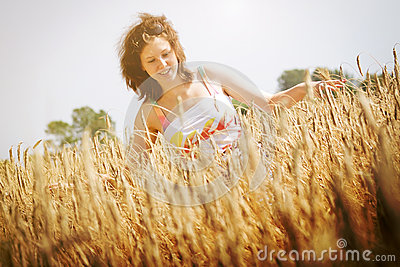 Young girl on the wheat field