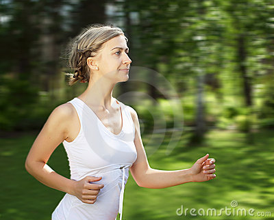 Young girl in a white shirt and red pants Stock Photo