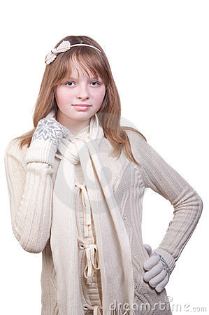 Young girl in white sweater, scarf and mittens