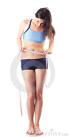 Young girl will measure a waist. Isolated