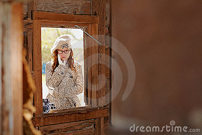 Young girl through a window