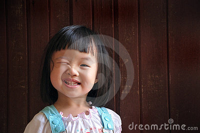 Young girl wink