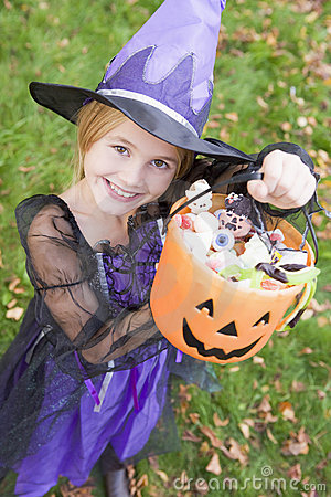 Young girl in witch costume on Halloween