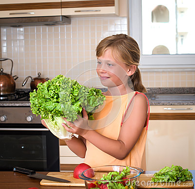 Free Young Girl With Fresh Lettuce. Healthy Food - Vegetable Salad. Diet. Dieting Concept. Healthy Lifestyle. Cooking At Home. Prepare Royalty Free Stock Image - 69346846