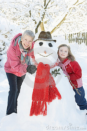 Free Young Girl With Grandmother Building Snowman Stock Image - 14189001