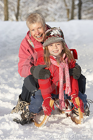 Free Young Girl With Grandmother Riding On Sledge Royalty Free Stock Photo - 14189035