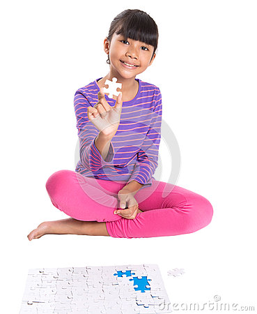 Free Young Girl With Jigsaw Puzzle Piece II Stock Images - 40059804