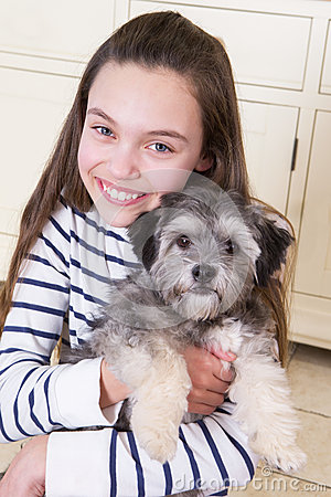 Free Young Girl With Puppy Royalty Free Stock Photography - 56353427