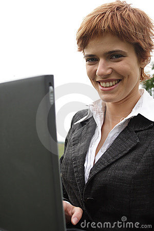 Young girl working on laptop