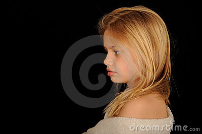 Young girl wrapped in towel