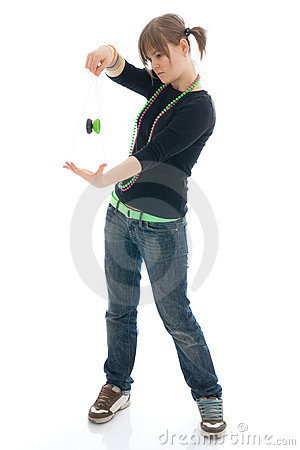 The young girl with the yo-yo isolated on a white
