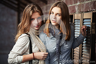 Young girls against a wall